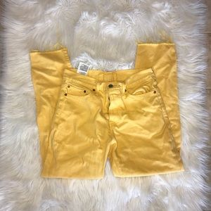 Cropped frayed yellow levis